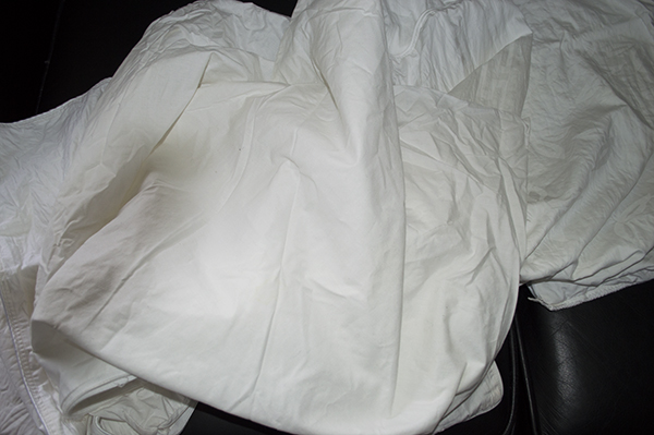 After boiling the bed linens in detergent & bleach, they are now white