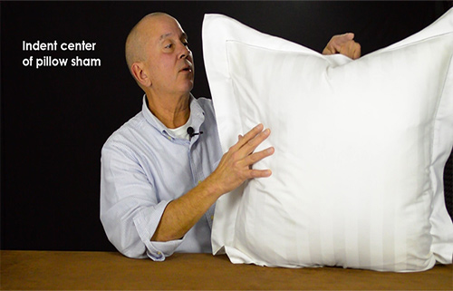 If the pillow flanges flop, make an indent on the top edge of the sham