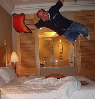 Man Jumping into bed