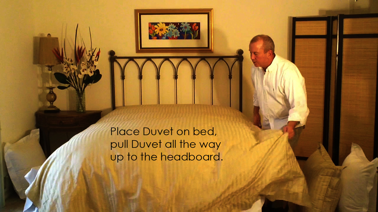 Pull the duvet cover up to the head board