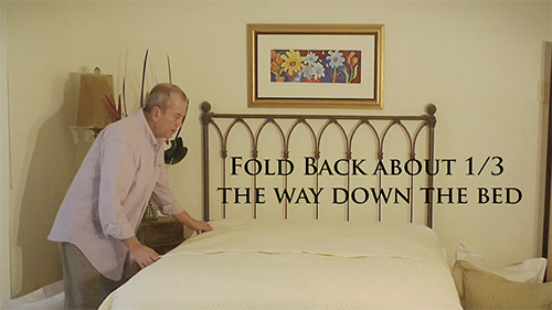 Place your coverlet on the bed and pull the top edge back