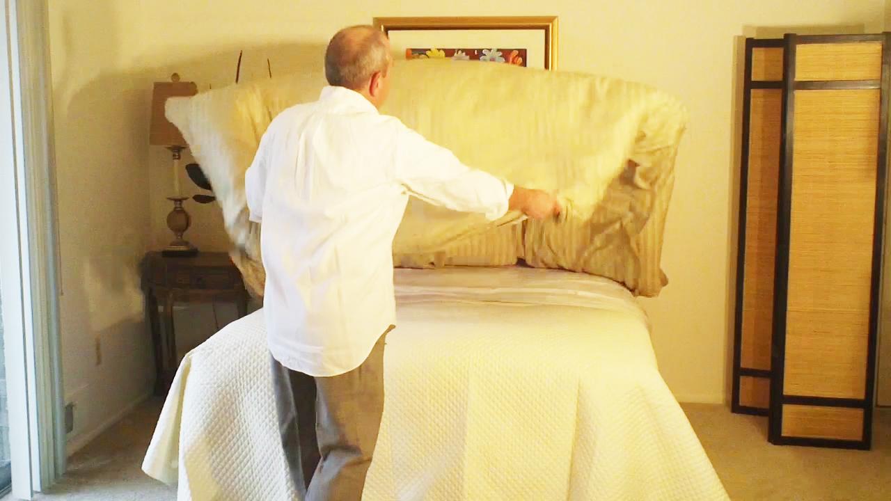 Shaking the duvet cover & down comforter
