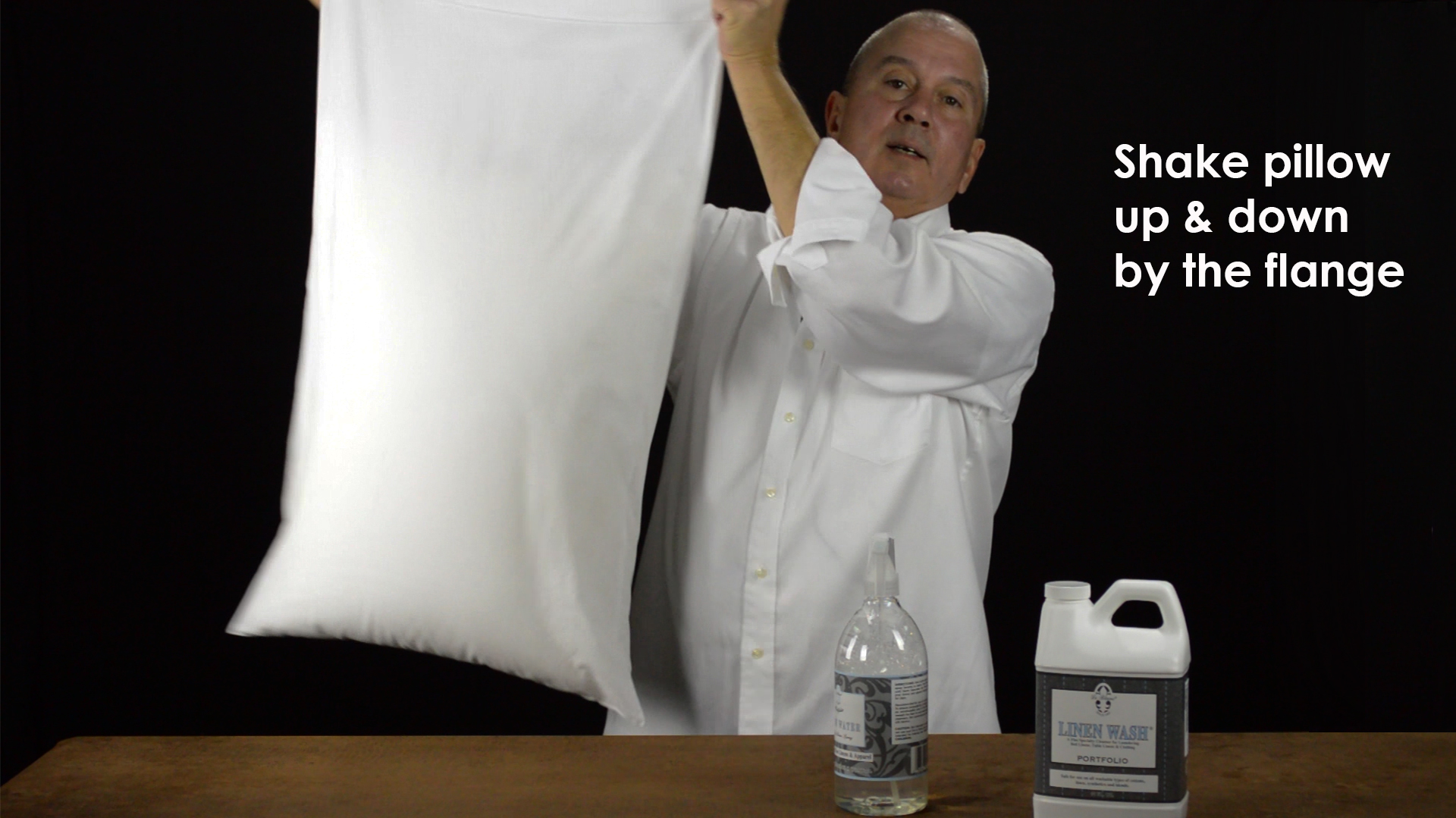 Shake pillow up and down to apply pressure on the damp fabric