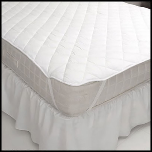 Straps help hold a mattress pad in place