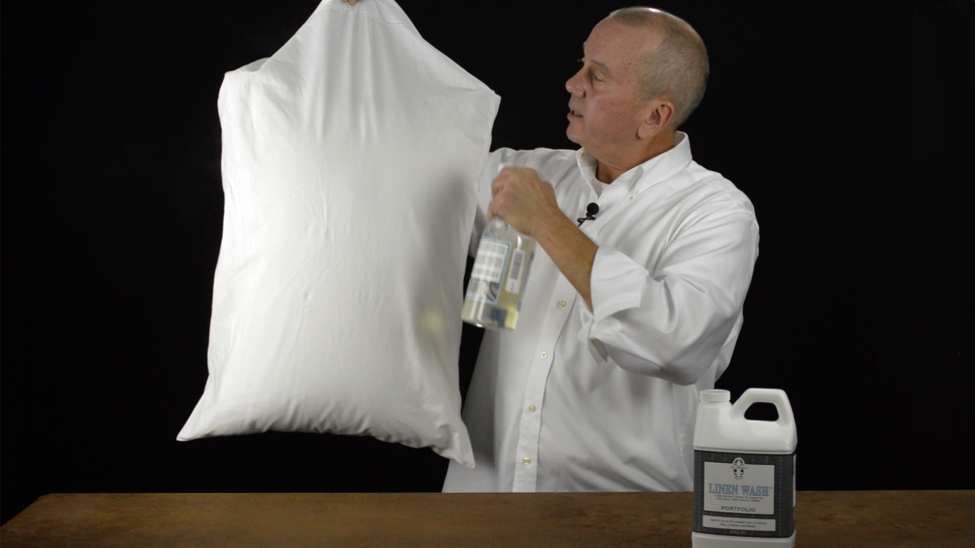 To eaisly get wrinkles out of your linens get a spray bottle of water