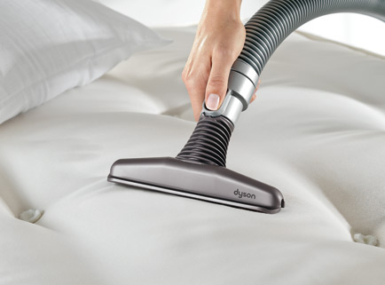 Vacuuming baking soda off the mattress